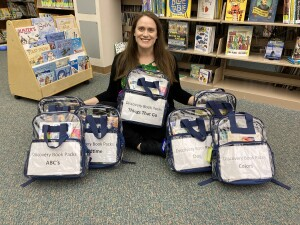 Katie with Discovery Book Packs Jan 2021